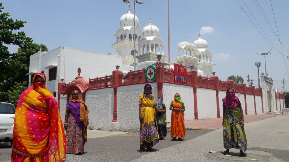 Women who had assembled in front of the LIG gurudwara hoping to get food on Sunday morning