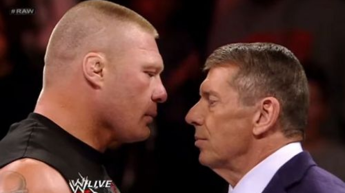 Brock Lesnar (L) with Vince McMahon