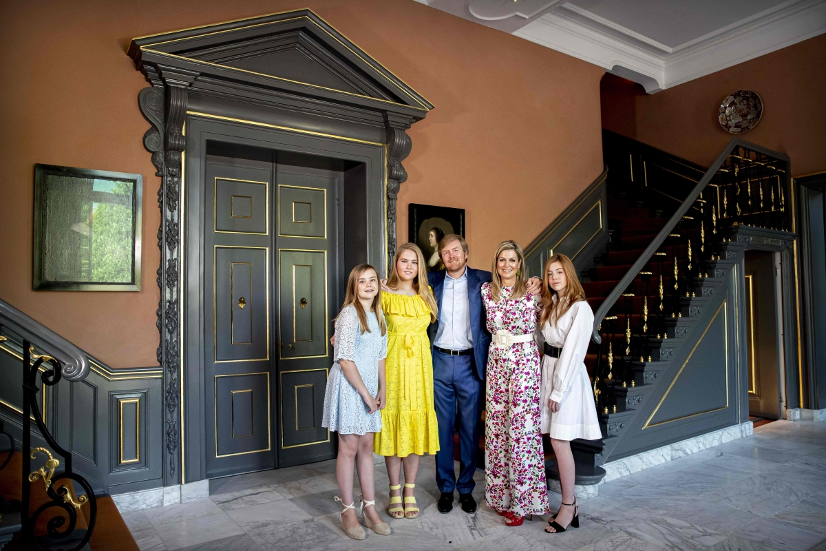 Dutch King Willem-Alexander, Queen Maxima (R) and their daughters pose as they celebrate Kings Day in The Hague on April 27, 2020.