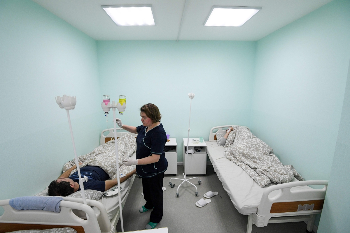 A patient receives a detox solution infusion at a private addiction clinic in Moscow.