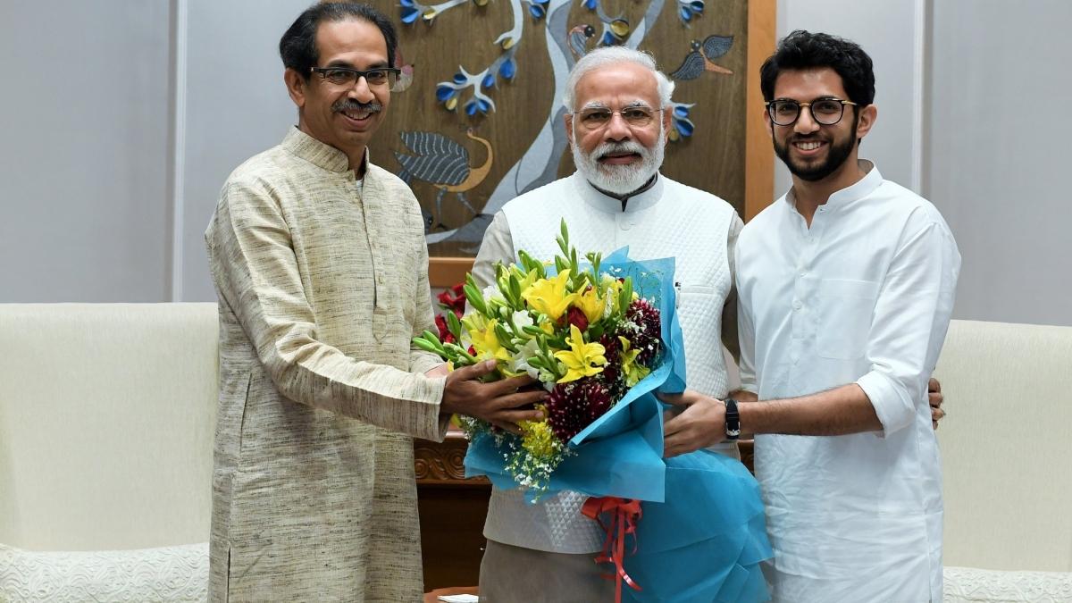 Aaditya Thackeray with PM Modi and Uddhav Thackeray