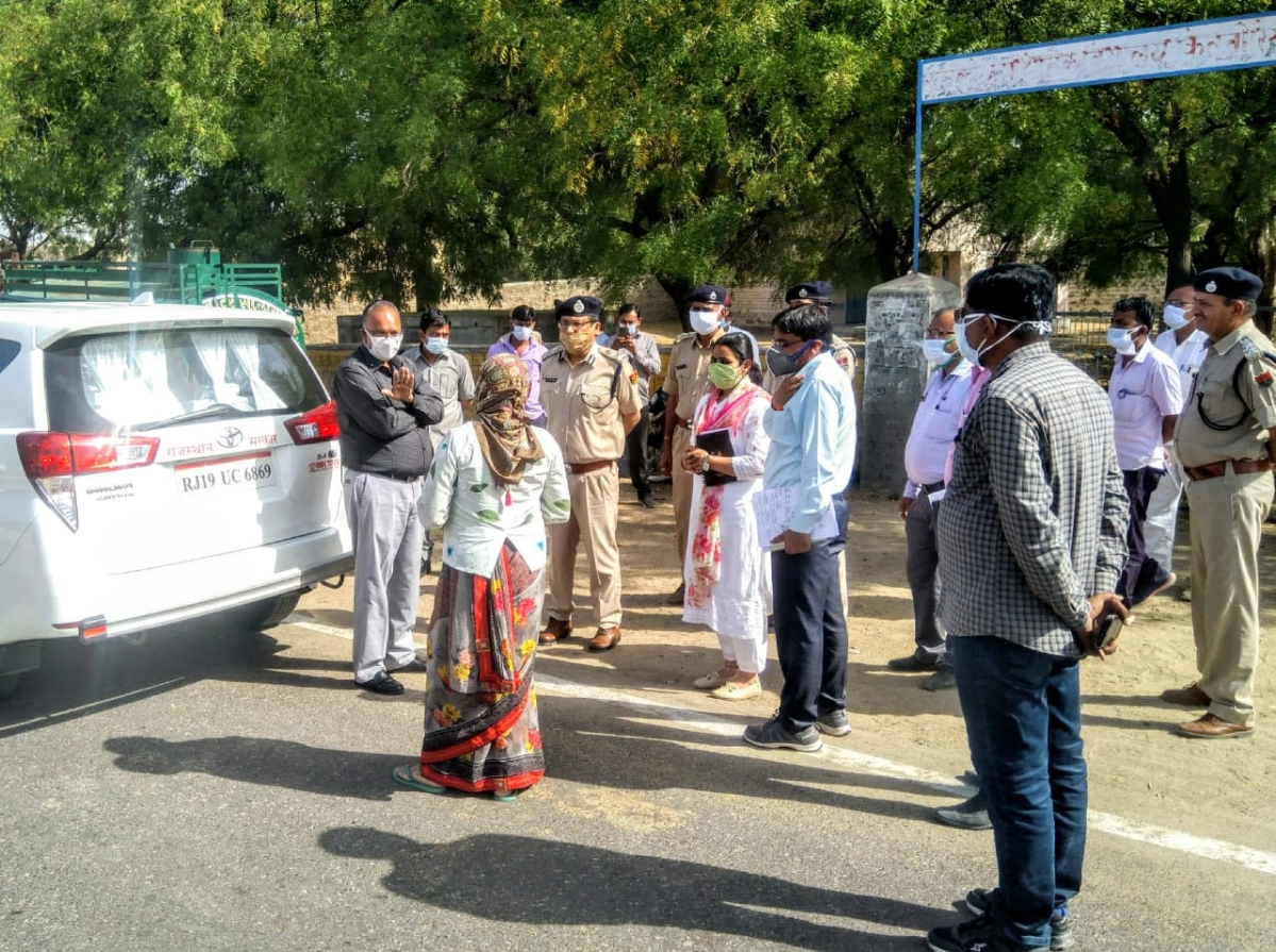 Administrative and police officers in Kitnoria village in Barmer