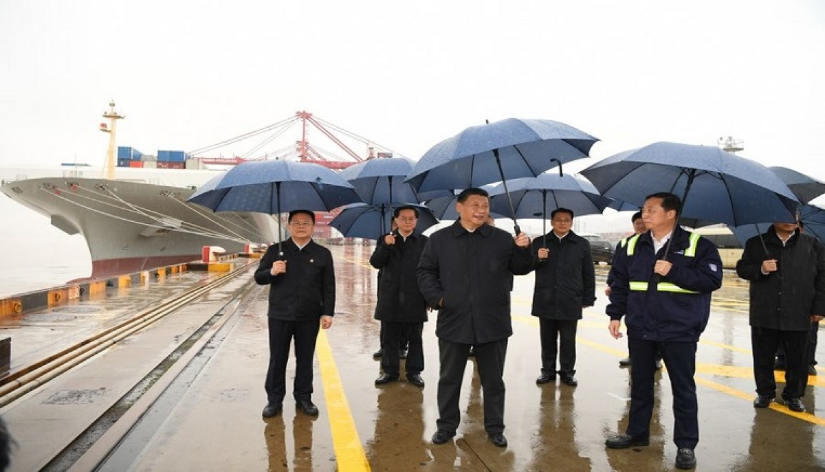 Chinese President Xi Jinping visits the Chuanshan port area of the Ningbo-Zhoushan Port in east China's Zhejiang Province, March 29, 2020.