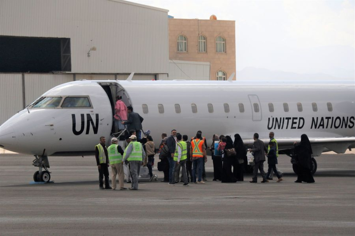 Yemeni patients and relatives board the UN-marked plane at the Sanaa International Airport in Sanaa, Yemen, on Feb. 3, 2020. The World Health Organization (WHO) announced on Monday that the first flight carrying Yemeni patients in critical need of treatment left the country's rebel-held capital Sanaa.