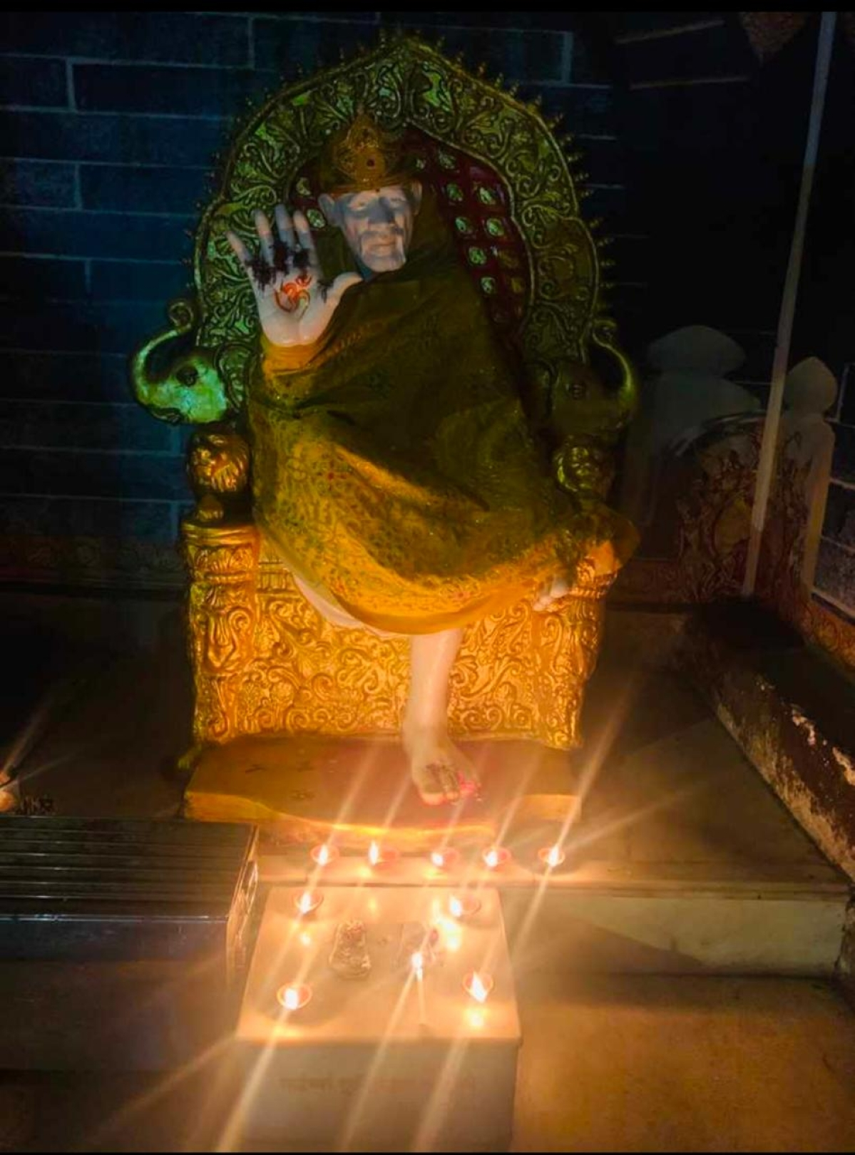 Chembur MLA Prakash Phaterpekar lights diyas in a Mandir outside his bungalow.