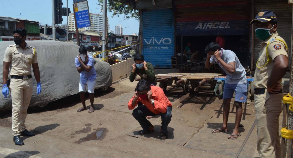 Mumbai police punish lockdown violators.