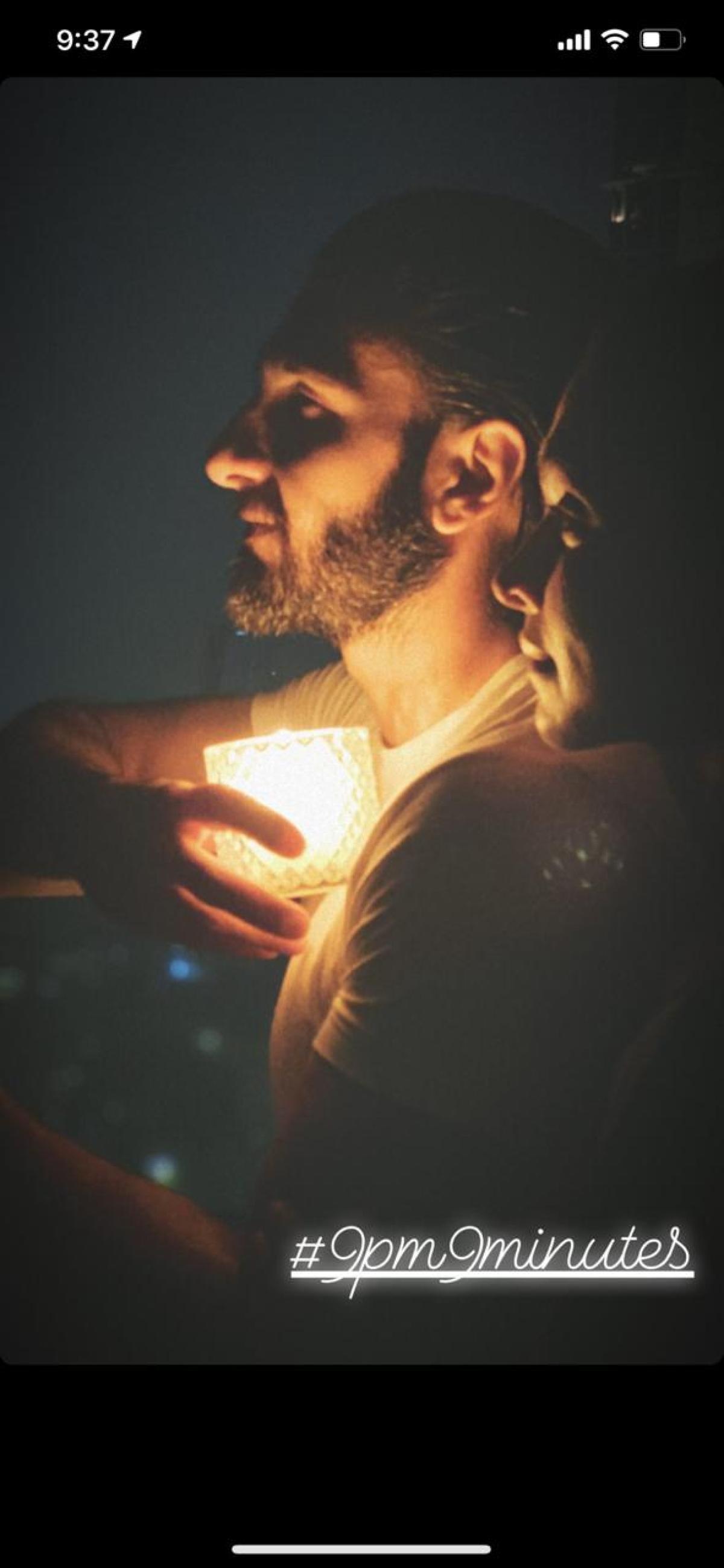 Deepika Padukone and Ranverr Singh lighting lamps.