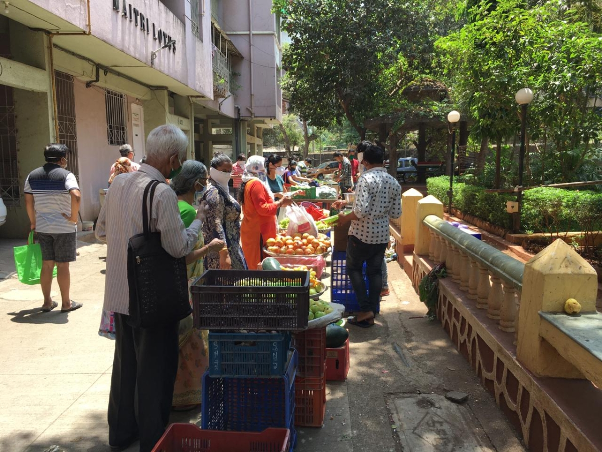 Residents of a Thane society following social distancing while buying vegetables