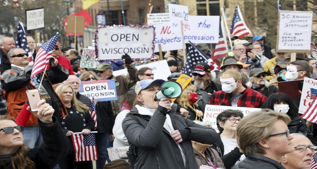 Thousands gather at Wisconsin state Capitol to protest coronavirus restrictions.
