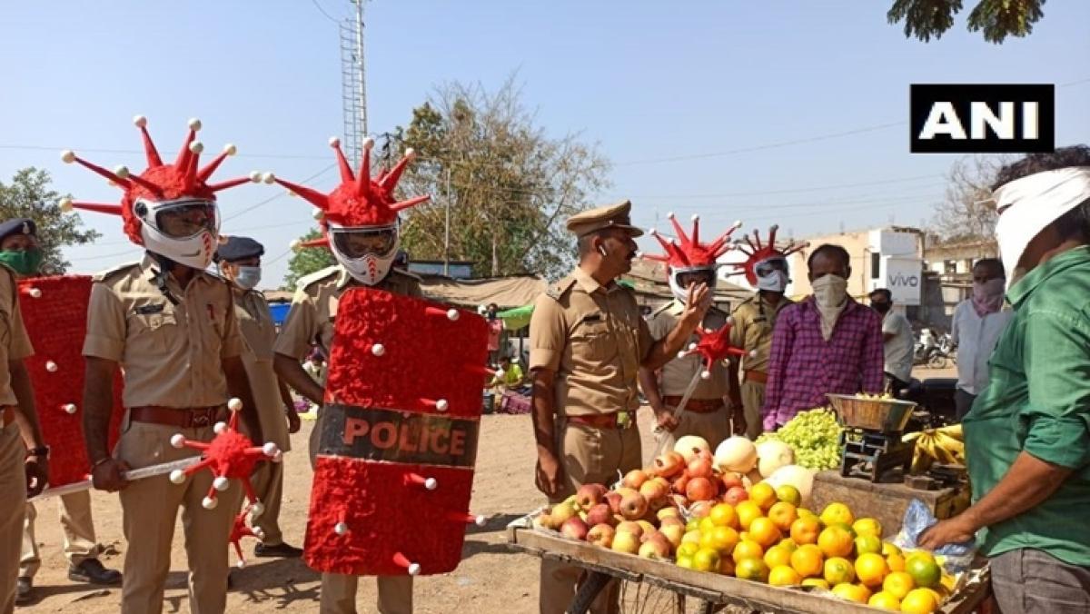 Gujarat Police personnel dress up as 'coronavirus' to create awareness