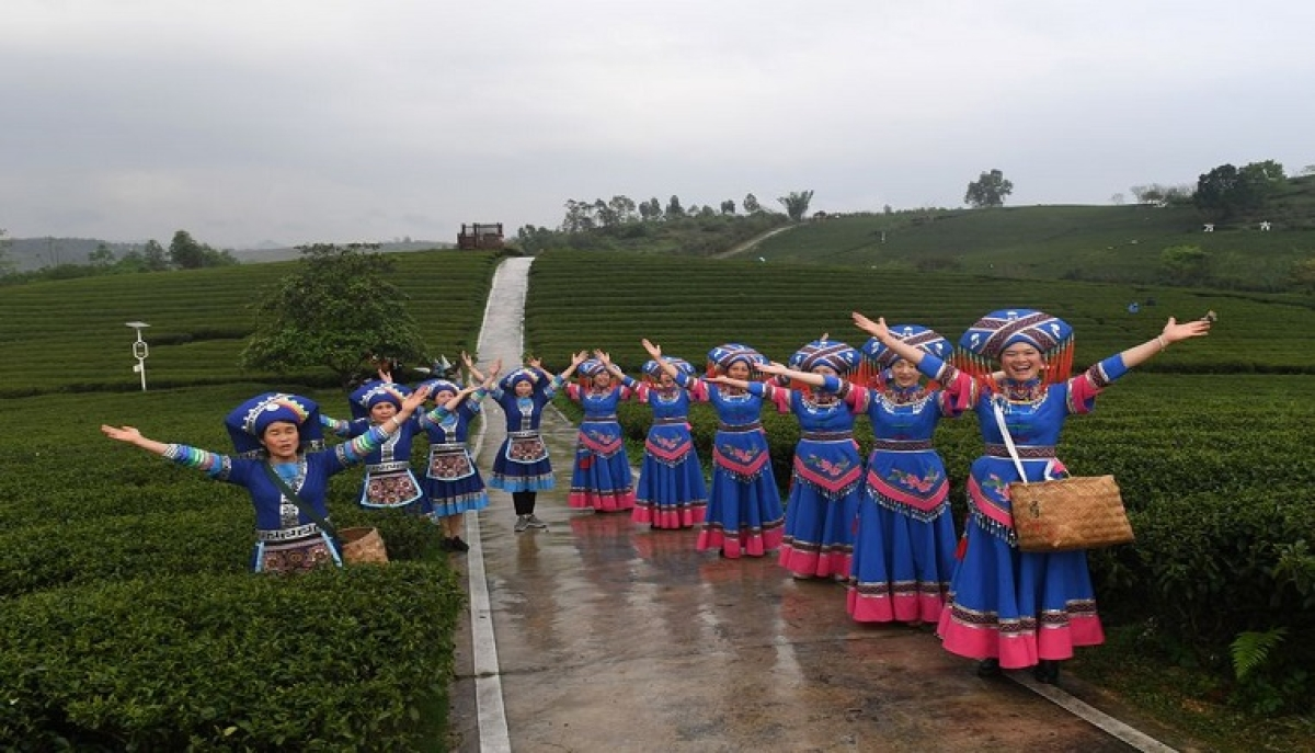 Residents from Shanglin county in southern China's Guangxi Zhuang Autonomous Region sing local folk songs during a livestreaming activity to sell local farm goods on March 24, 2020.