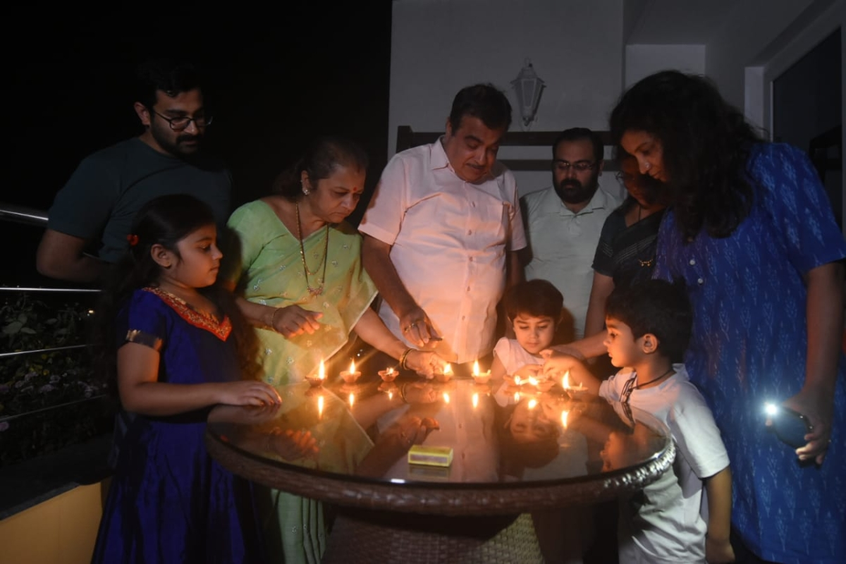 A family lighting lamps in Dombivli