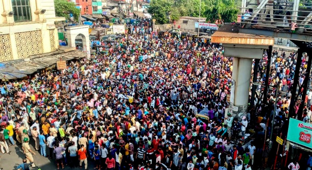 Coronavirus in Mumbai: Sea of migrants in Bandra demand to return home, view pics