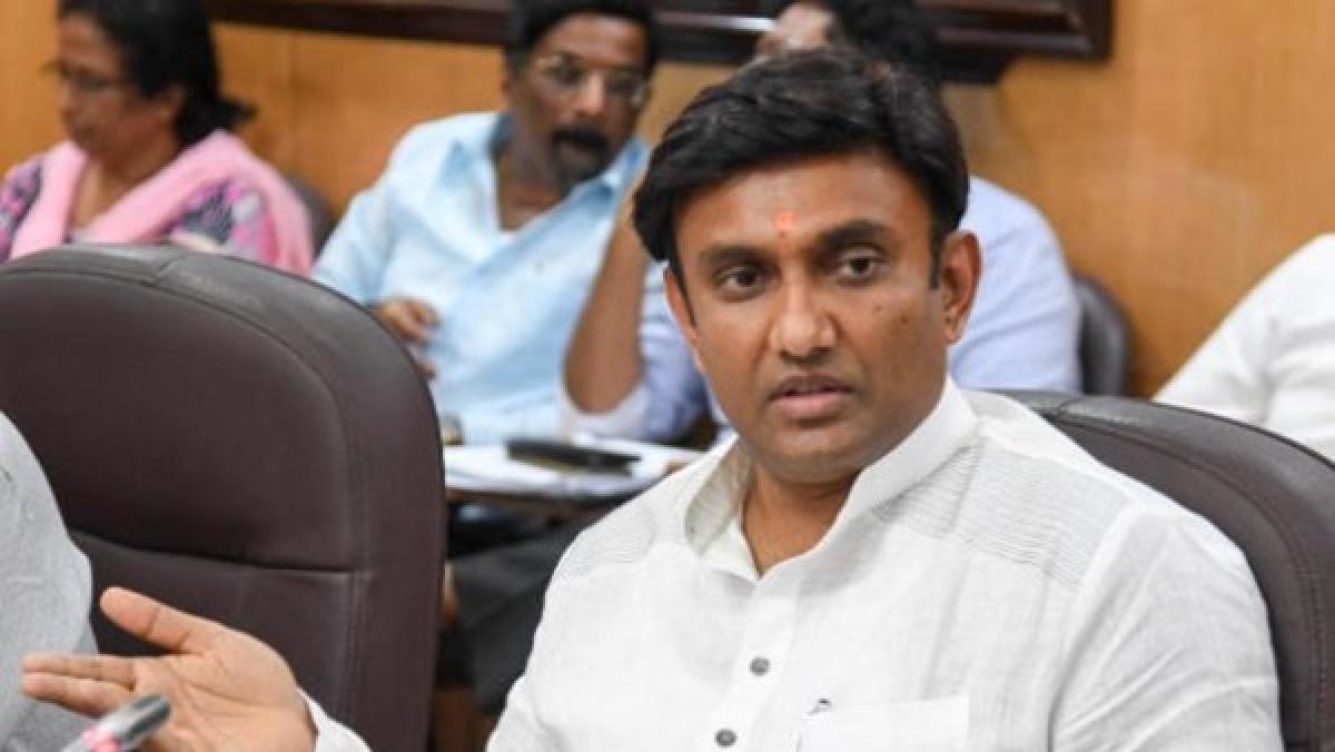 Dr K Sudhakar,