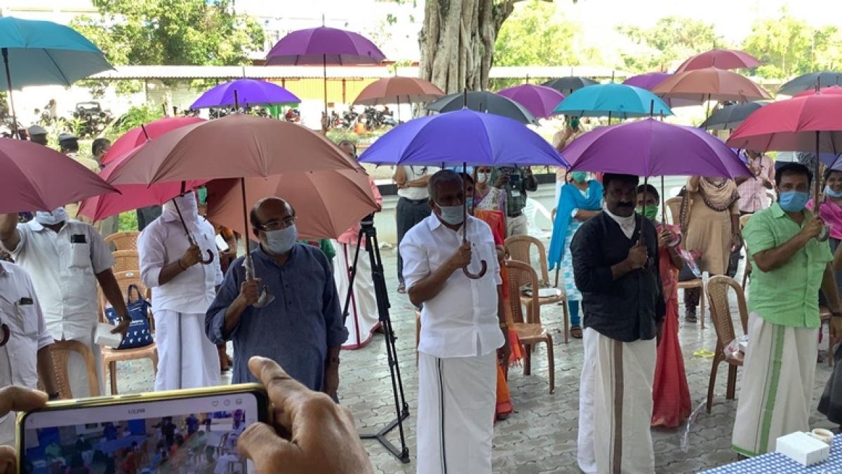 Kerala's Thanneermukkom Gram Panchayat makes use of umbrellas mandatory for social distancing