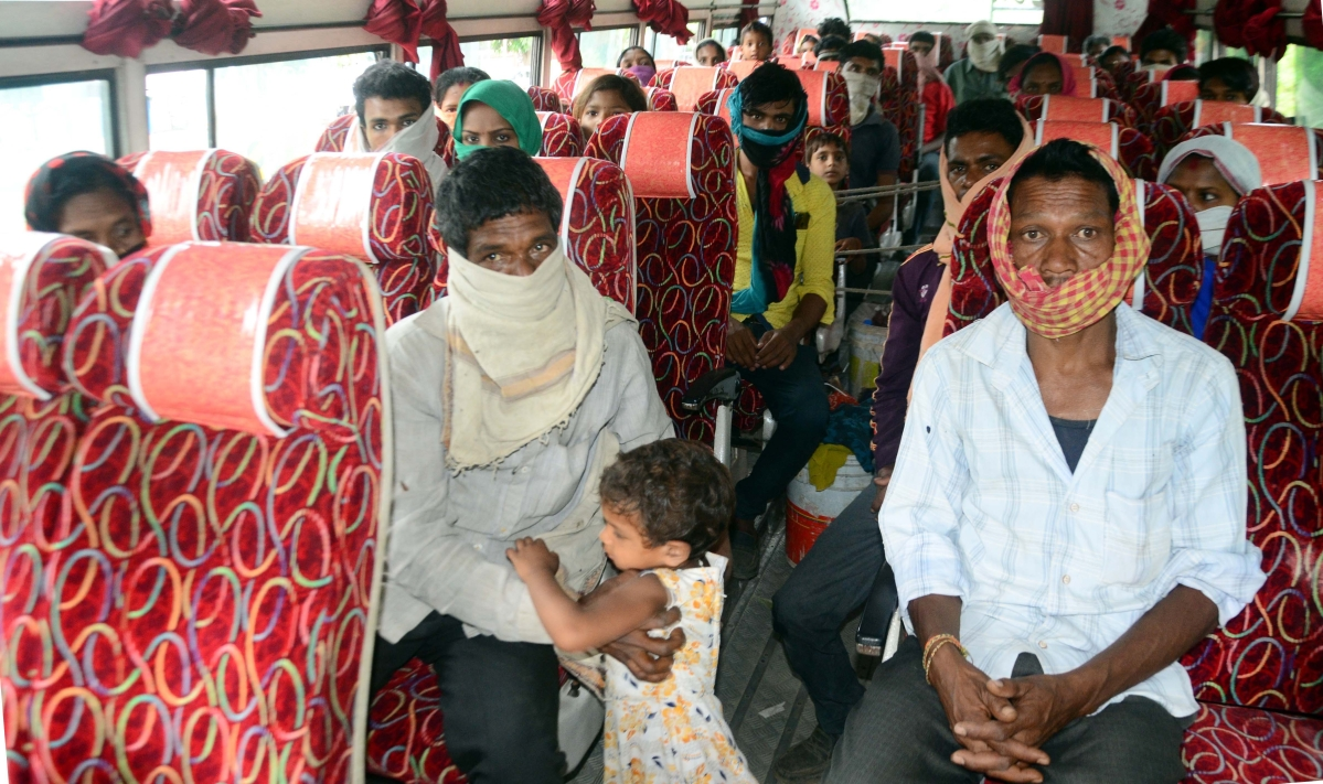 Migrant workers being sent back to their native place amid nationwide lockdown in wake of coronavirus pandemic, in Bhopal on Wednesday