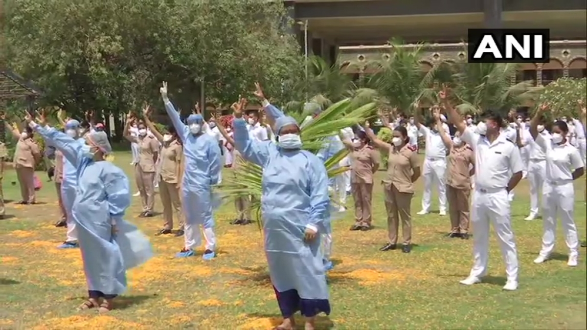Indian Air Force helicopter showers flowers on the staff of Indian Navy's INHS Asvini in Mumbai.