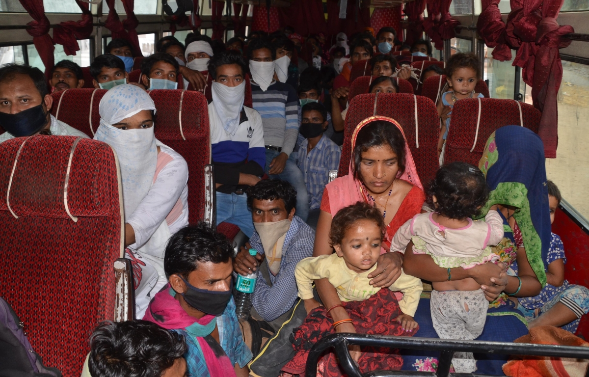 Migrants who were stranded in the city due to lockdown sent back to their native places by the district administration authorities during a government-imposed nationwide lockdown as a preventive measure against the COVID-19,  in Bhopal on Wednesday