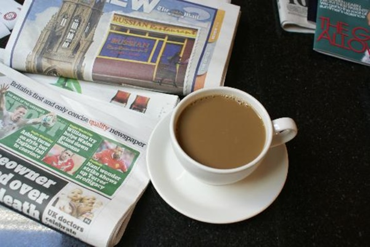 Joy in the morning: A newspaper with their morning cuppa