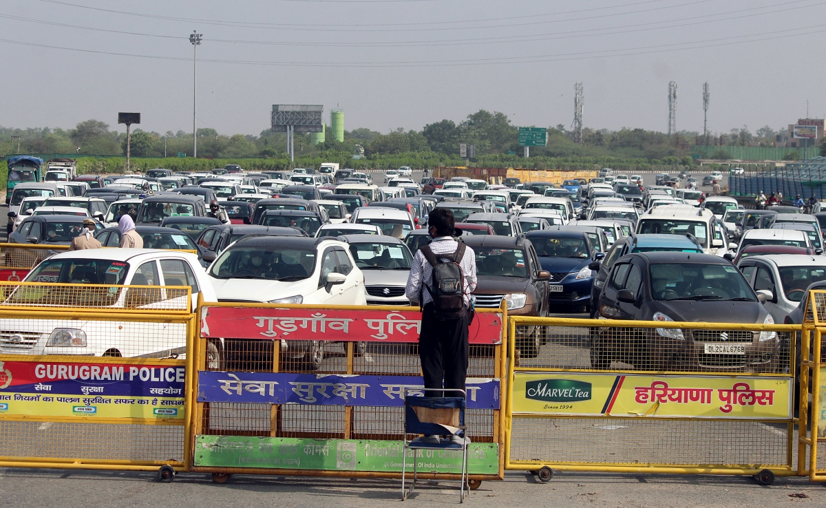 Long queue of vehicles at Delhi-Gurugram border as police check passes of the people commuting through this route.