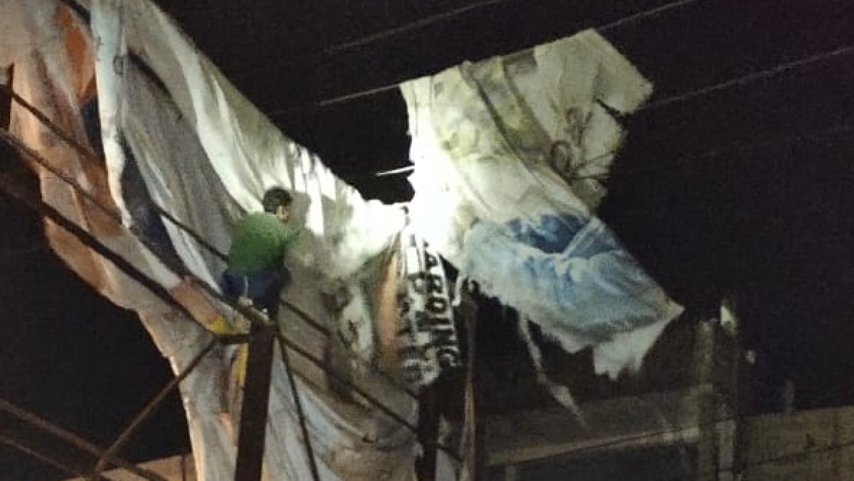 Torn cloth of a hoarding fell on an electricity line causing fault that led to disruption in power supply on Sunday night.