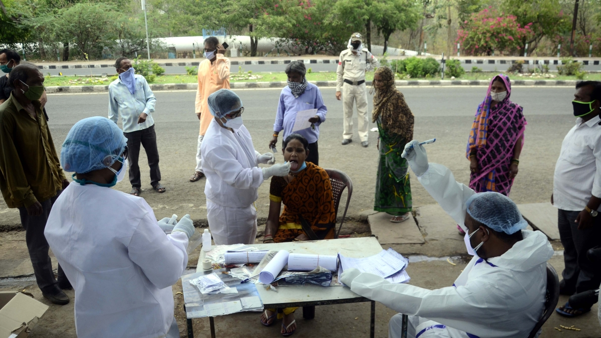 Medics collects swab tests for people living in a containment area during  nationwide COVID-19  lockdown, in Bhopal