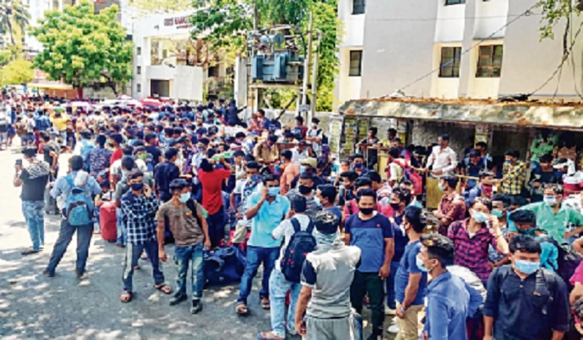 Hundreds of migrants from different states gather as they demand arrangements to be made to send them back, in Chennai.