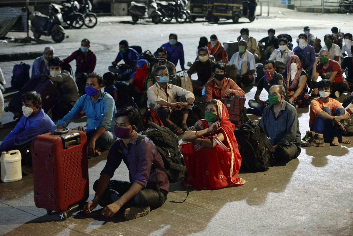 Migrants awaiting home-bound trains outside Borivali Railway Station, Mumbai on Monday