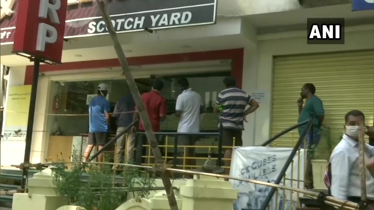 What social distancing? Booze lovers throng to liquor shops as MHA relaxes rules on sale of alcohol; Watch video