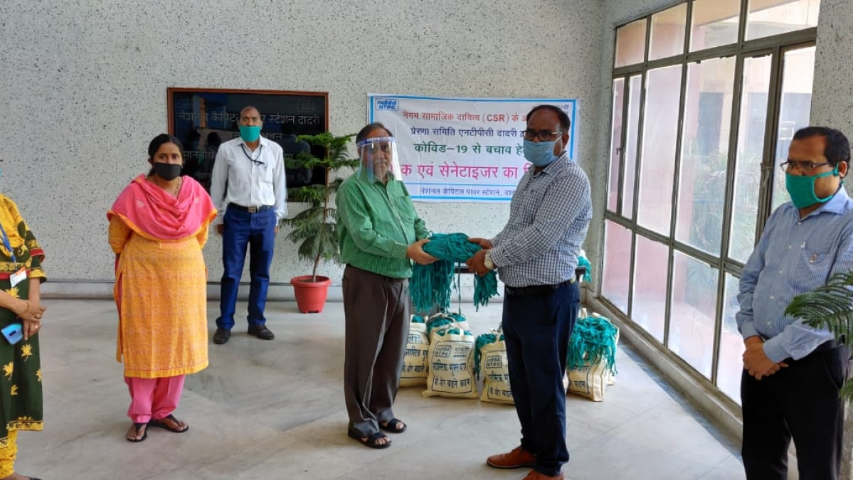 NGO Prerna Samiti (NTPC Dadri) distributes 3200 masks & 100 sanitizers to gram pradhans of 16 nearby villages