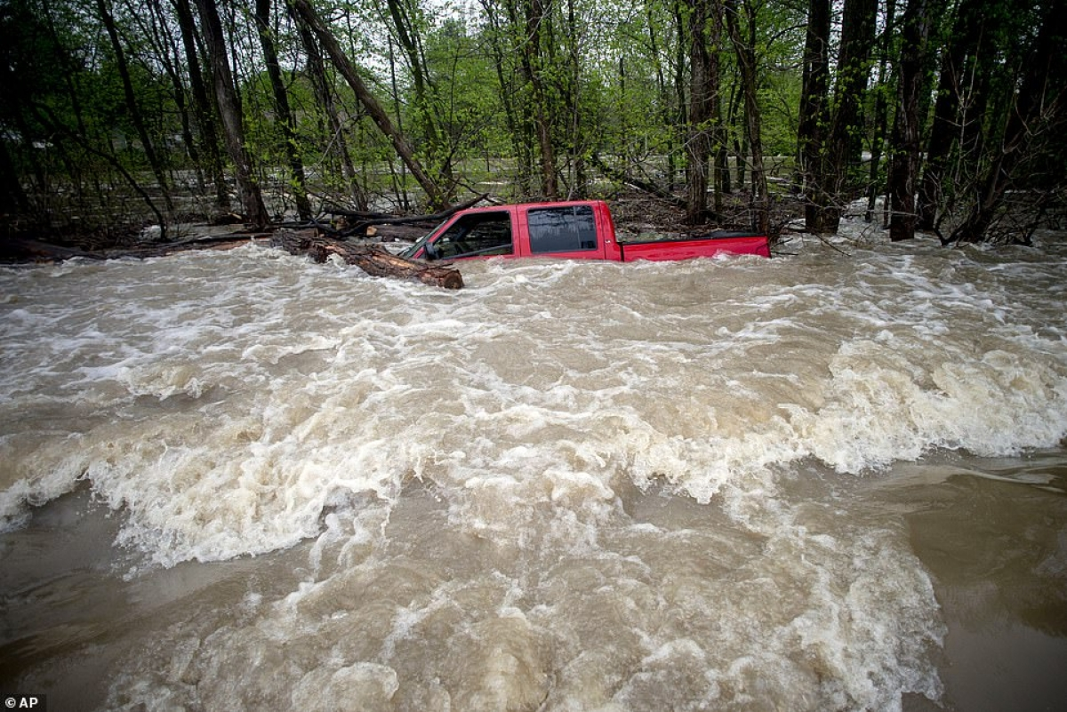 The driver of red pickup truck was rescued in Saginaw County, Michigan.