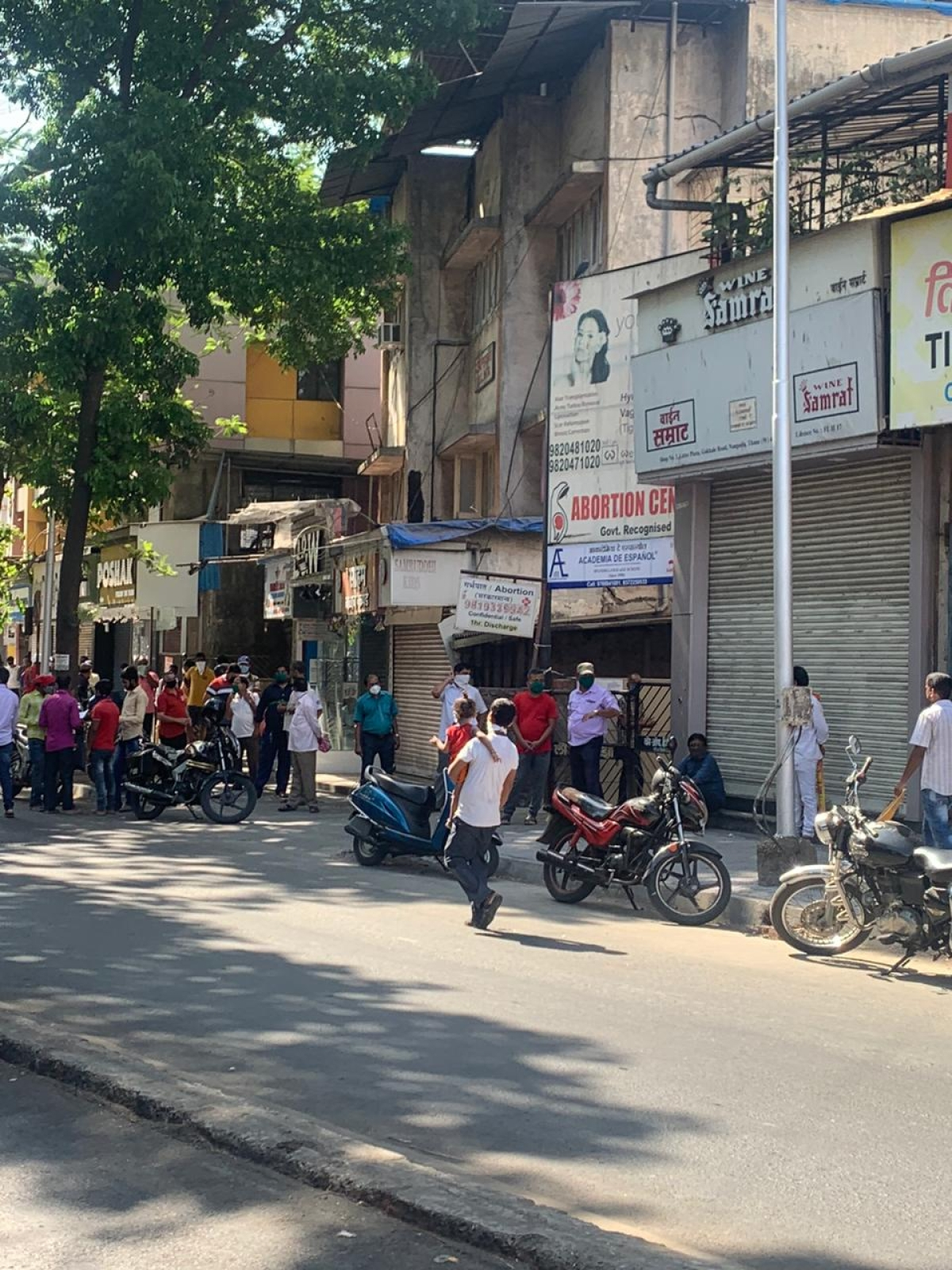 Tipplers at Thane's famous Gokhale Road queue up to anxiously wait for the opening of liquor shop and its purchase