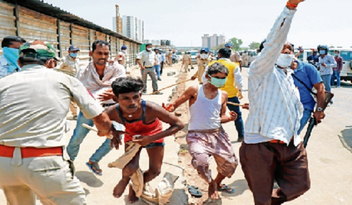 Migrants hurl stones at cops in Ahmedabad; 100 detained