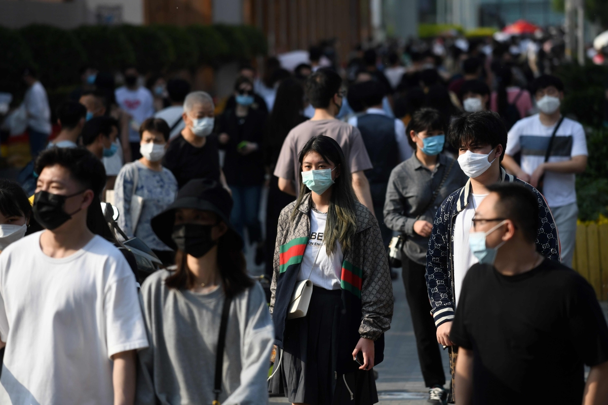 People wear face masks as a preventive measure against COVID-19 in Beijing.