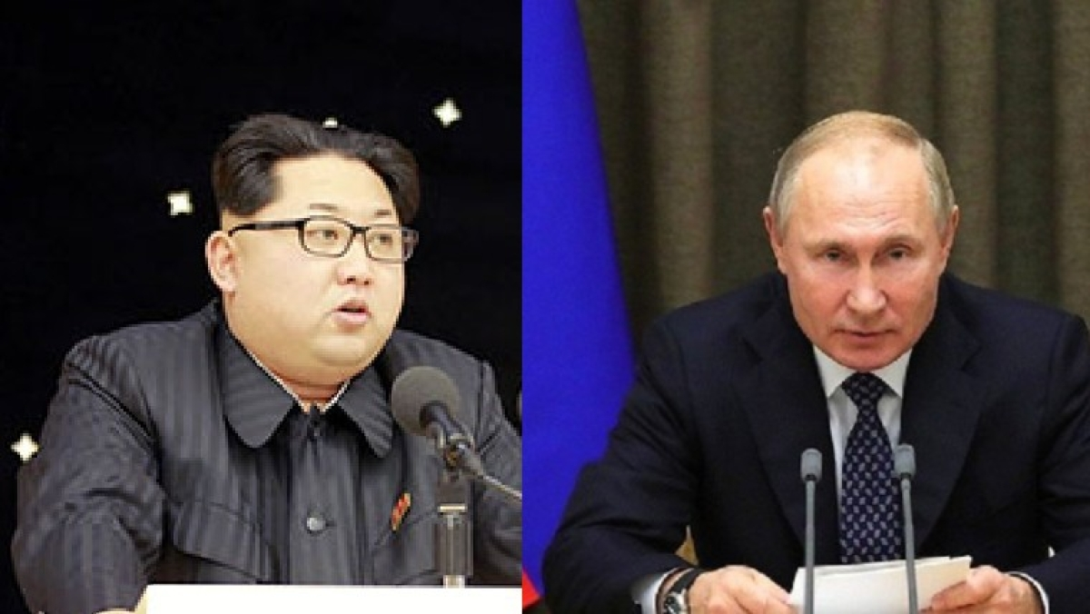 Vladimir Putin awards Kim Jong Un with a commemorative war medal to mark the 75th anniversary of victory over Nazi Germany