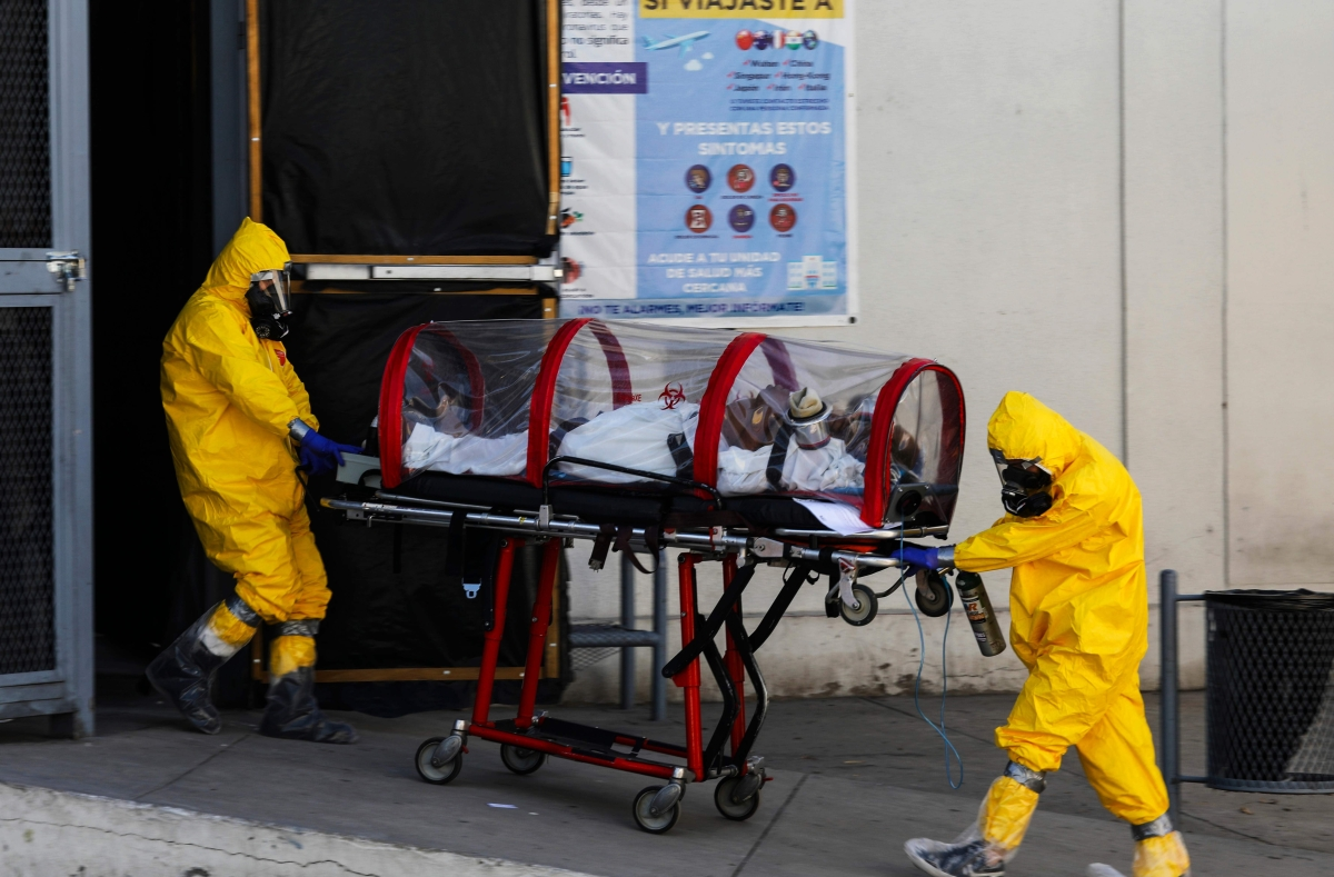 Paramedics transport a patient suspected of being infected with the novel coronavirus in Mexico.