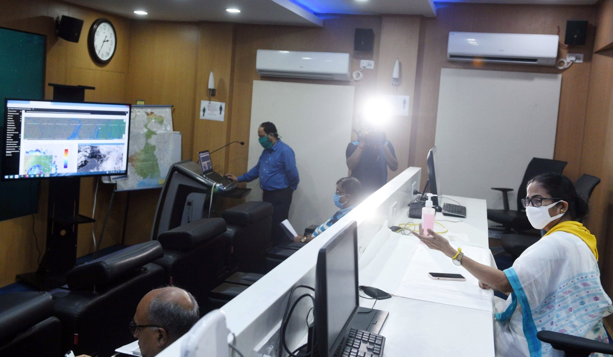 West Bengal Chief Minister Mamata Banerjee reviewing arrangements during cyclone Amphan at a control room set up in her office building, in Kolkata on Wednesday