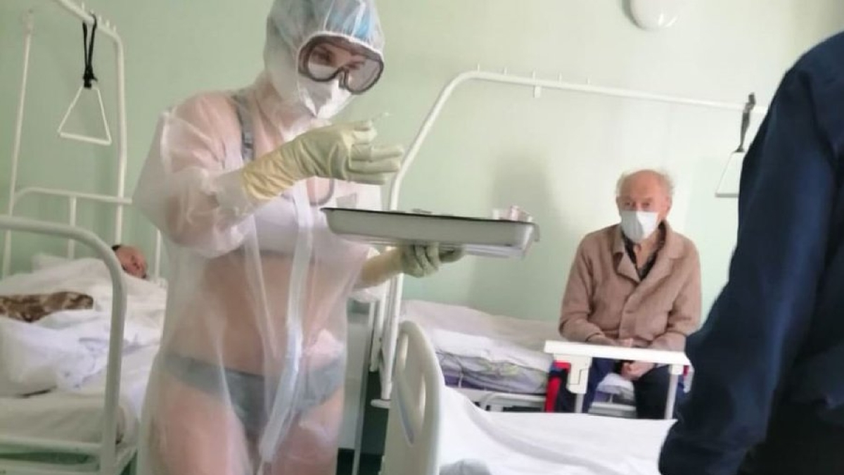 """Russian nurse wears lingerie under PPE suit, says """"it gets too hot for clothes"""""""