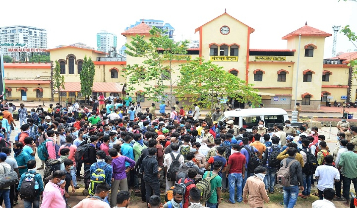 Migrant workers gather near the Mangaluru Central Railway  Station, hoping to travel back to their homes in Mangaluru.