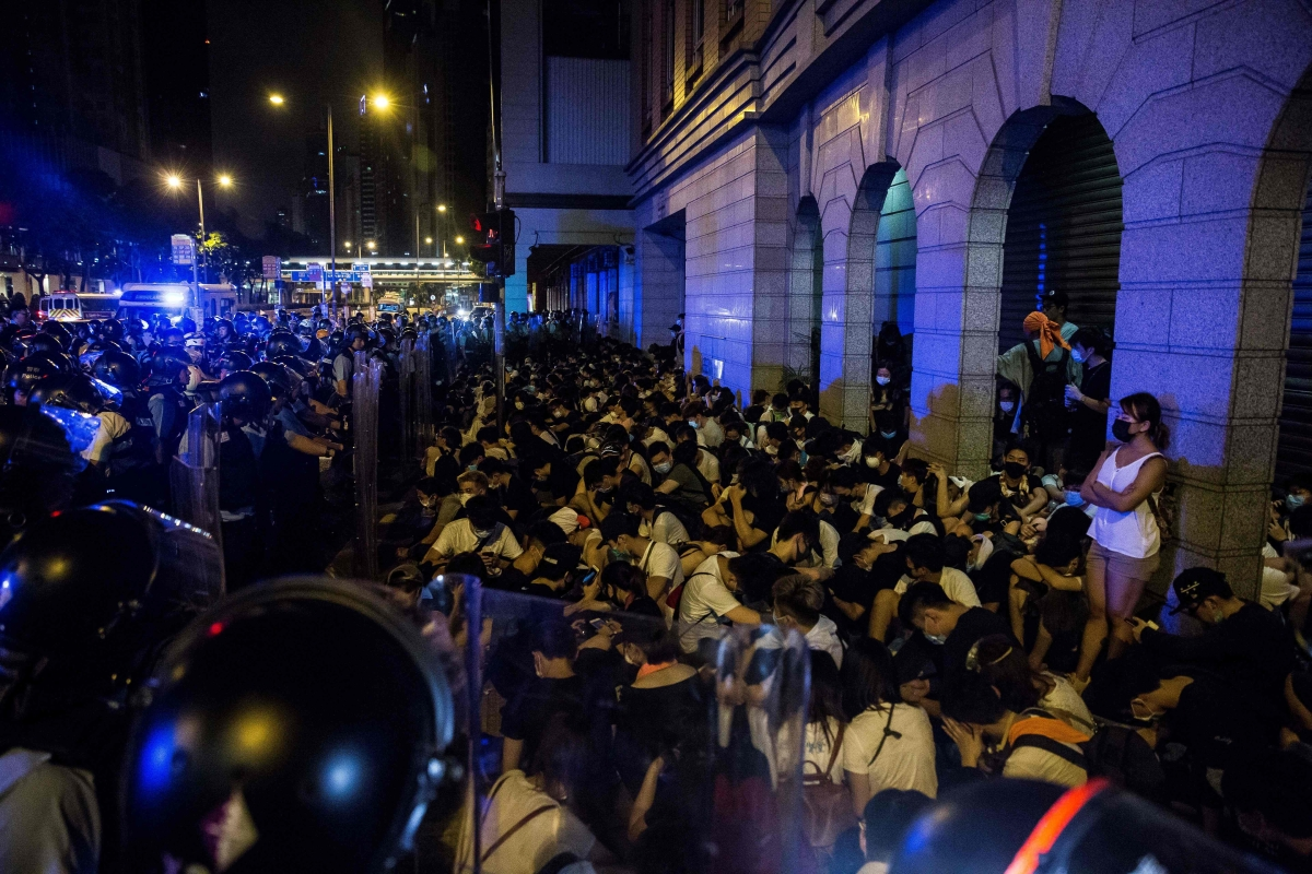 A file photo of protesters are detained by police after a rally against a controversial extradition law proposal in Hong Kong