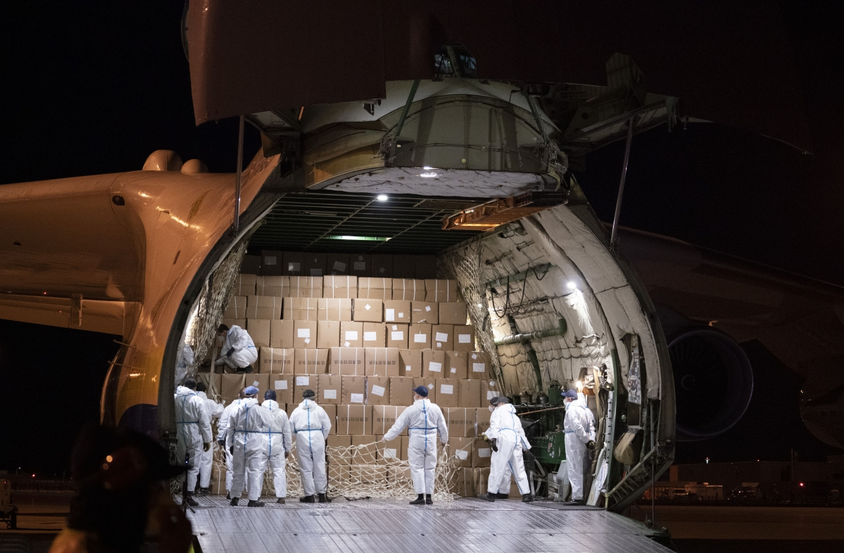 A crew prepares to unload medical supplies arriving from China from a Antonov AN-225 cargo transporter at Mirabel Airport in Mirabel, Quebec, Friday, May 1, 2020, during the coronavirus pandemic.