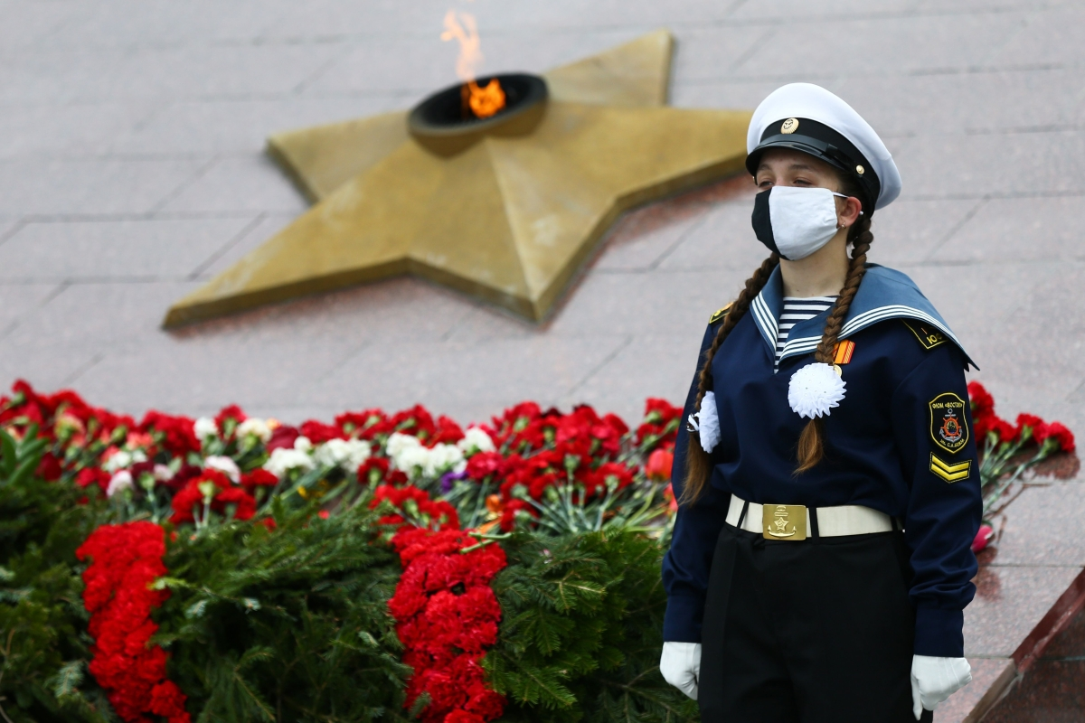 A Russian cadet stands guard in front of a military memorial during a ceremony to mark the Victory Day.