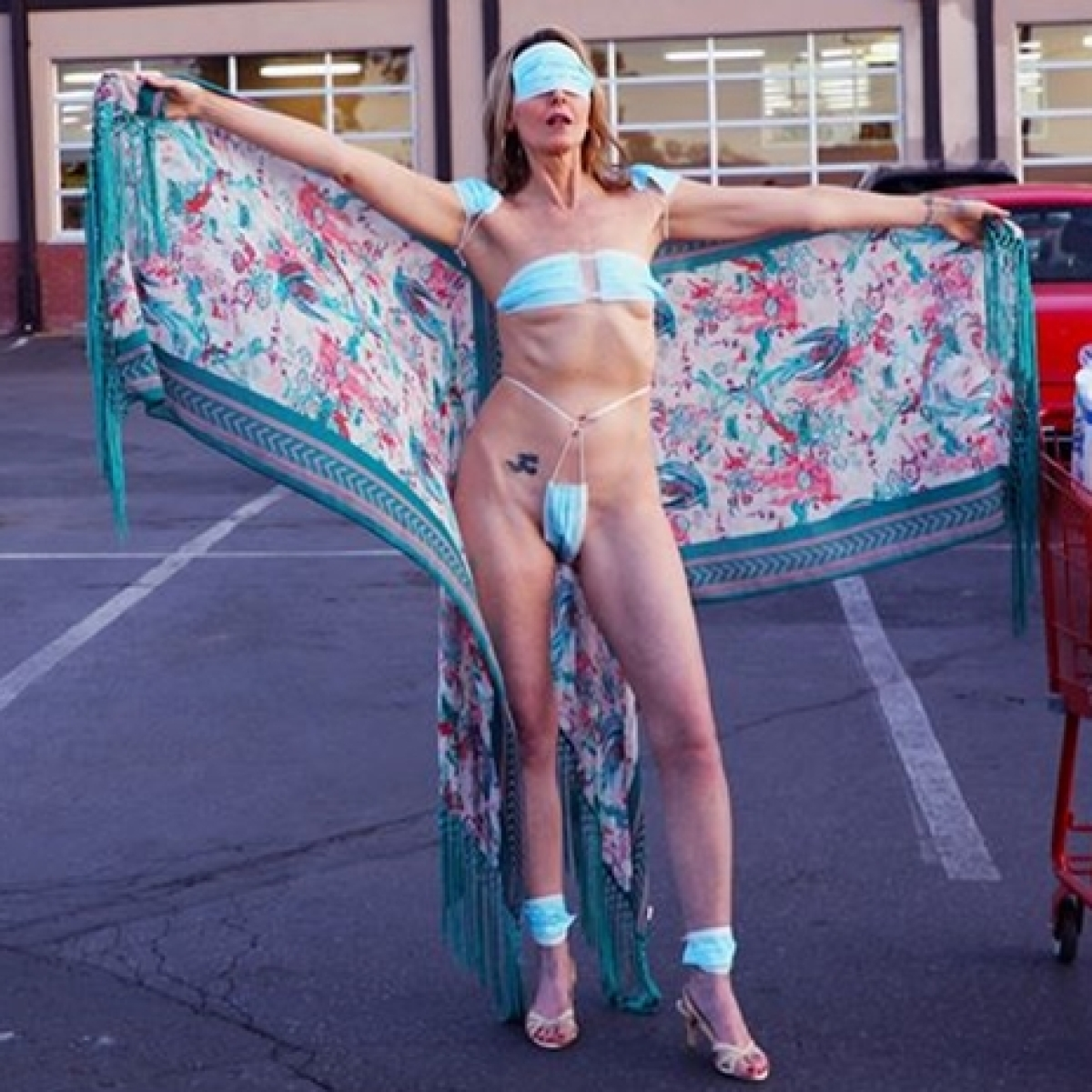 Woman wears bikini made of masks but doesn't cover face to protest against COVID-19 restrictions