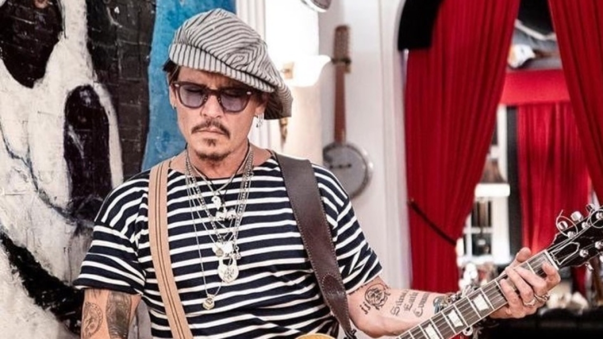 Johnny Depp unveils the priceless piece of art he has been working on for over 14 years