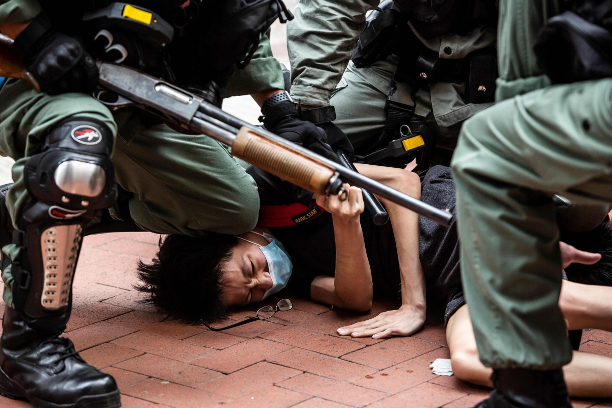 Police arrest Pro-democracy protesters in Hong Kong.