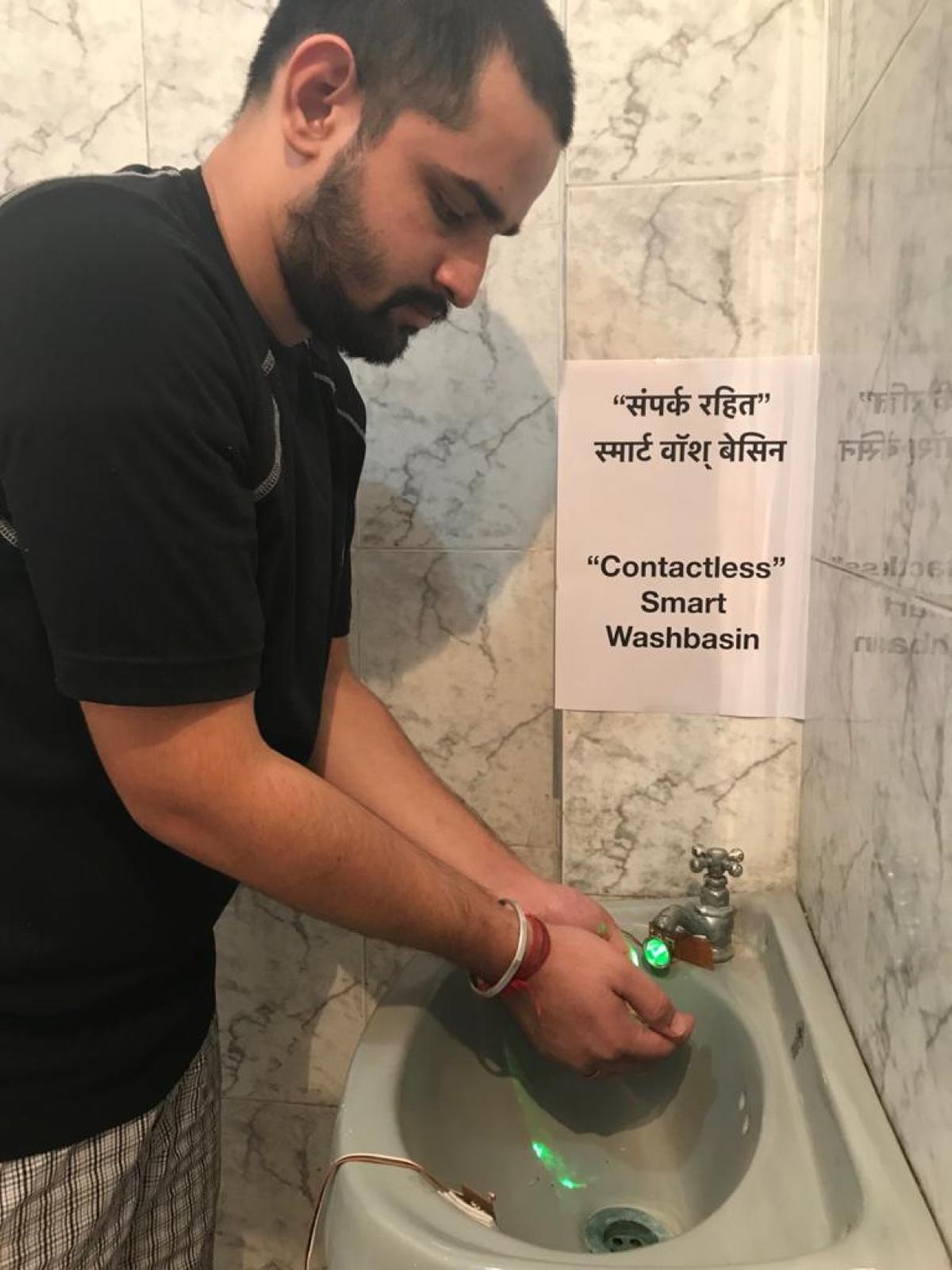 Vaibhav using his Contactless Smart Wash Basin
