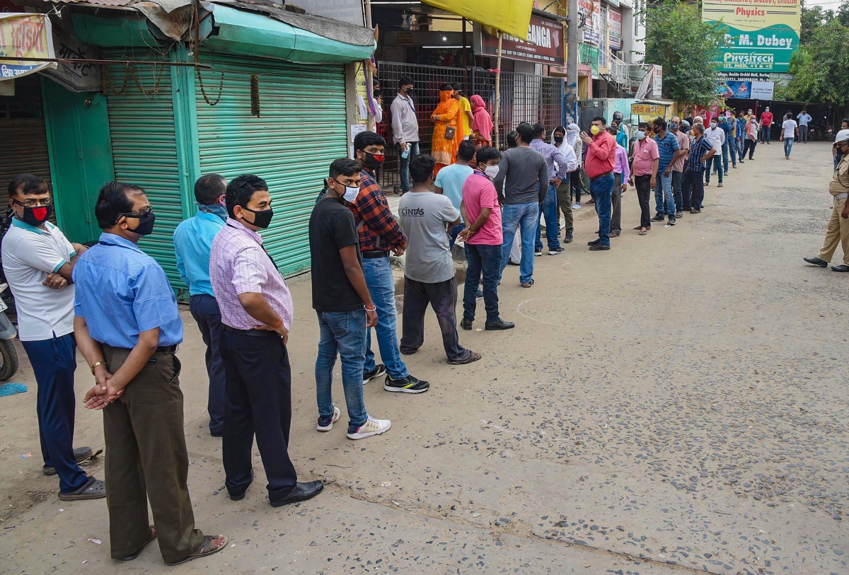 People queue-up outside a book shop to purchase stationery items in Patna on Monday. Stationery shops opened after the Ministry of Home Affairs in its revised lockdown guidelines exempted such establishments.