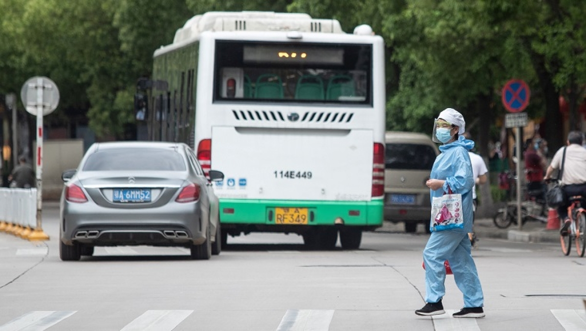 What are some of the precautions taken by China while reopening workplaces and public spaces?