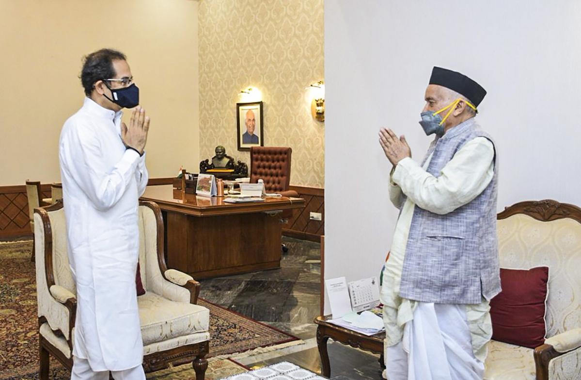 Maharashtra Chief Minister Uddhav Thackeray greets Governor Bhagat Singh Koshyari during a meeting at Raj Bhavan, Mumbai, Friday, May 1, 2020.