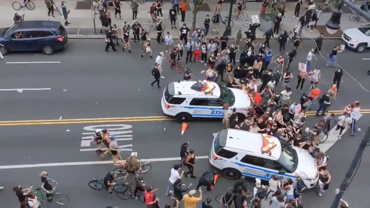 George Lloyd's death: NYPD uses police car to push protesters back; incident on video